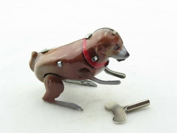 Blechspielzeug - Kleiner hüpfender Hund