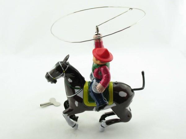 Blechspielzeug - Cowboy auf Pferd mit Lasso