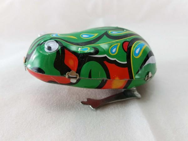 Blechspielzeug - Hüpfender Blechfrosch mit Augen