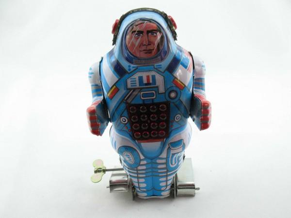 Blechspielzeug - Roboter-Astronaut mit Feuerstein auf Raupenfüßen